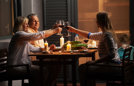Parents and teen drink wine with a meal