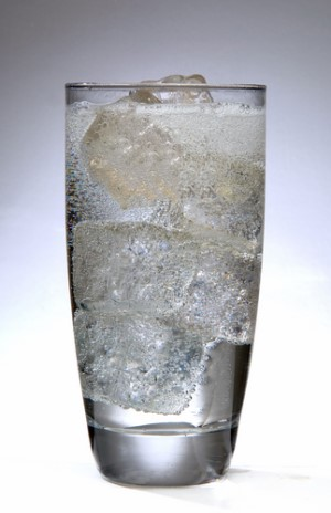 A glass of soda water filled with ice