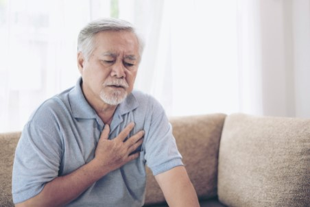 An older man is at home suffering chest pain